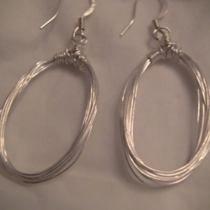 Wrapped Artistic Silver Wire with Sterling Silver ear hooks. 2 inches in length. Alecia Keyes has a pair of these gorgeous earrings.